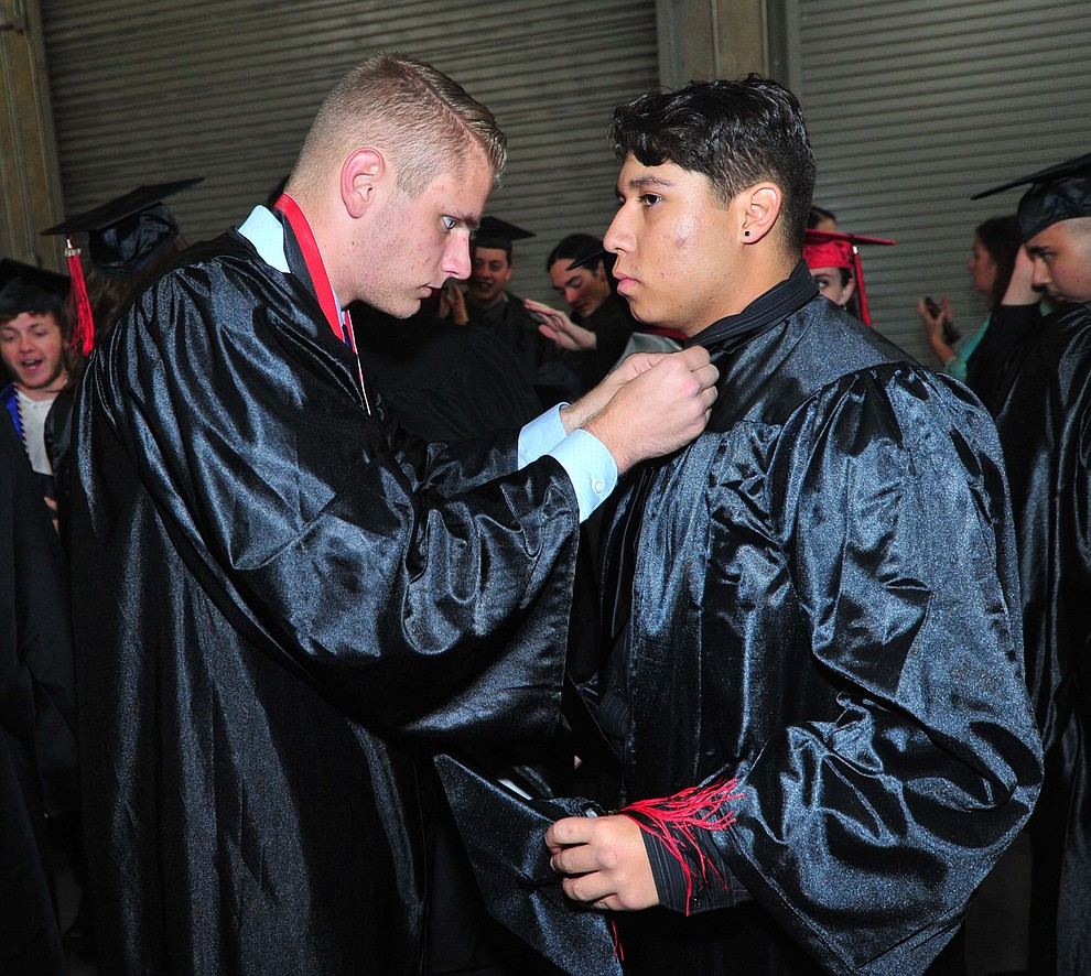 Owen Mayotte helps Michale Villa before Bradshaw Mountain High School graduated 334 students in a commencement ceremony Thursday, May 23 at the Findlay Toyota Center in Prescott Valley. (Les Stukenberg/Courier)