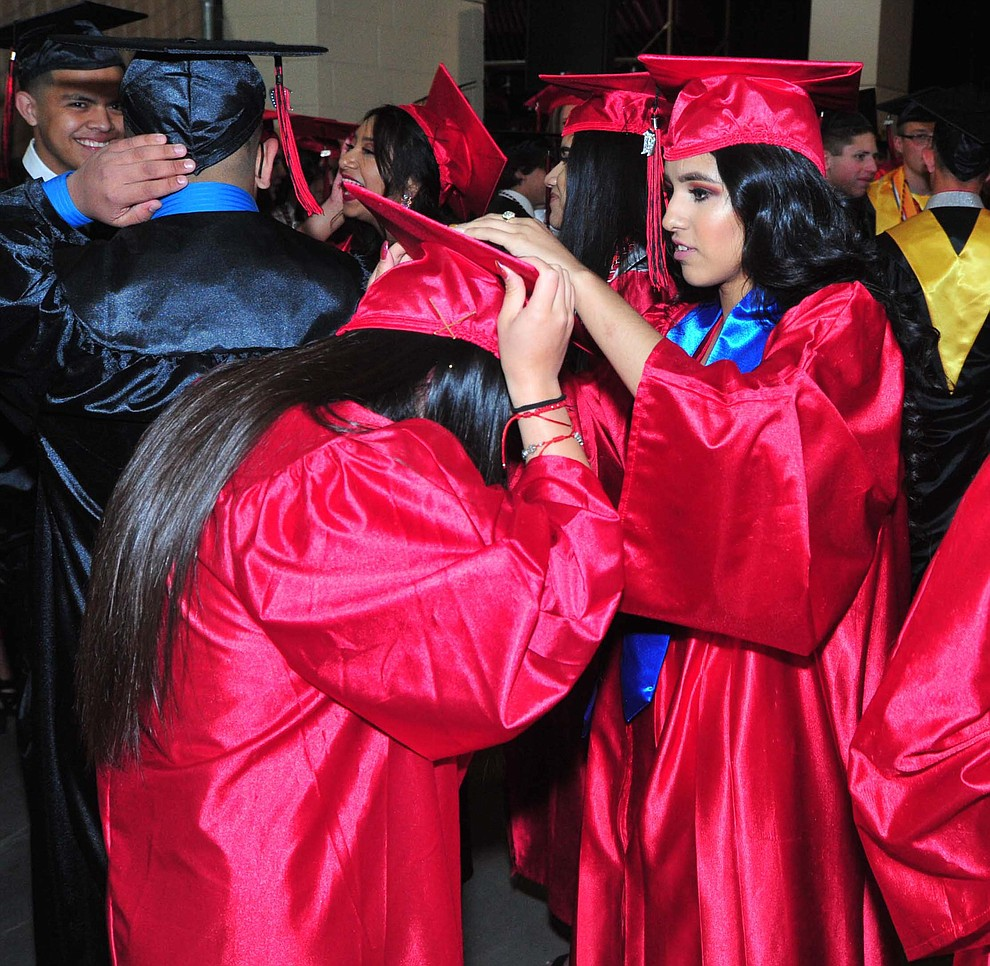 Jocelyn Carino helps Lizette Jasso Mendoza Bradshaw Mountain High School graduated 334 students in a commencement ceremony Thursday, May 23 at the Findlay Toyota Center in Prescott Valley. (Les Stukenberg/Courier)
