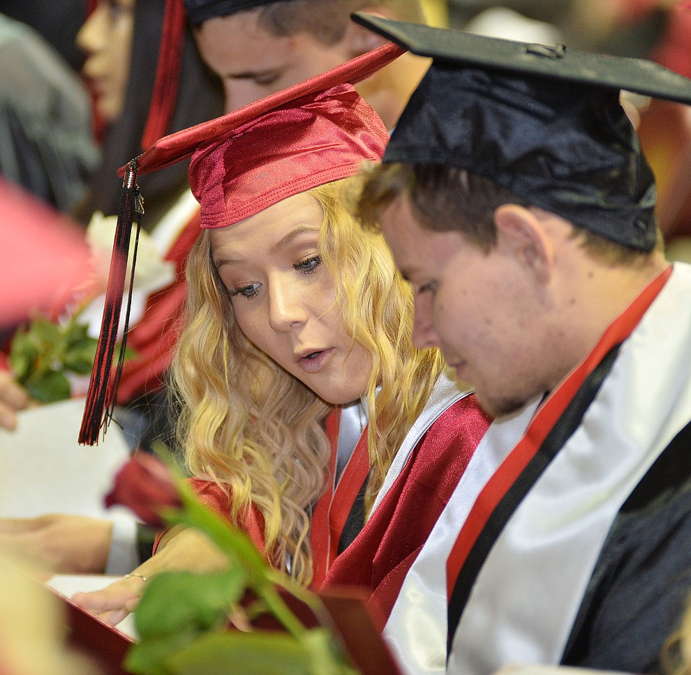 Graduates look at what's actually in their diploma holder as Bradshaw Mountain High School graduated 334 students in a commencement ceremony Thursday, May 23 at the Findlay Toyota Center in Prescott Valley. (Les Stukenberg/Courier)