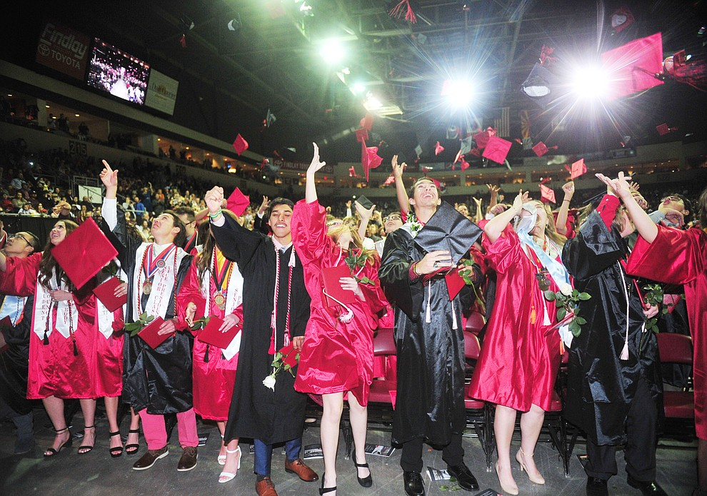 Graduates toss their mortar boards up as Bradshaw Mountain High School graduated 334 students in a commencement ceremony Thursday, May 23 at the Findlay Toyota Center in Prescott Valley. (Les Stukenberg/Courier)