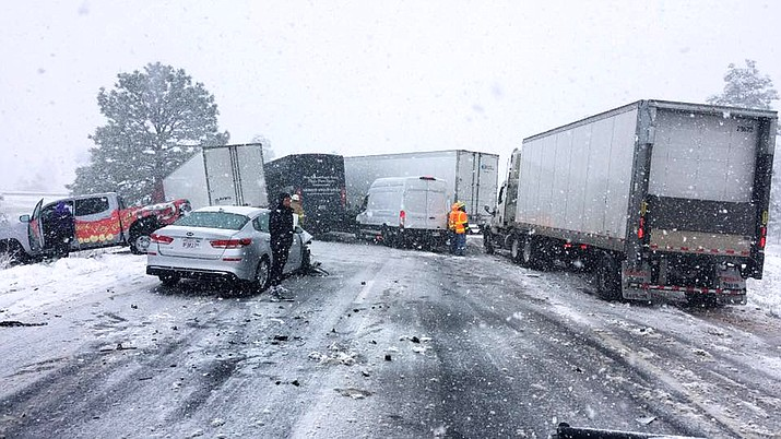 A multi-vehicle accident blocked I-40 westbound at milepost 178 near Parks May 23. A late spring snowstorm contributed to the accident. (AZDPS/photo)