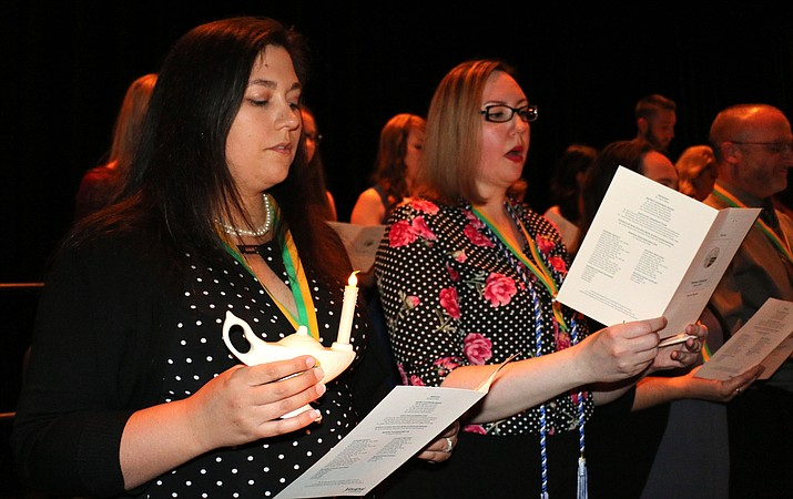 Yavapai College Nursing Program graduates from both the Prescott and Verde Valley Campus spring cohorts recite the Florence Nightingale Pledge during a traditional pinning ceremony May 11 at the YC Performing Arts Center. Yavapai College courtesy photo