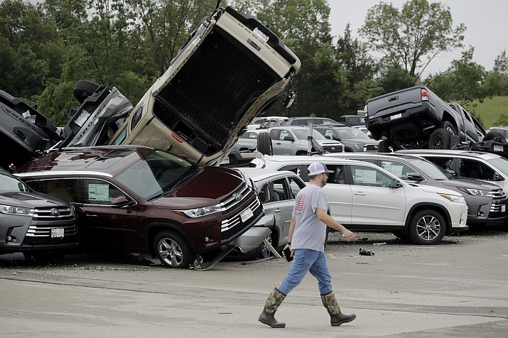 A worker walks past tornado-damaged Toyotas at a dealership in Jefferson City, Mo., Thursday, May 23, 2019, after a tornado tore though late Wednesday. (Charlie Riedel/AP)