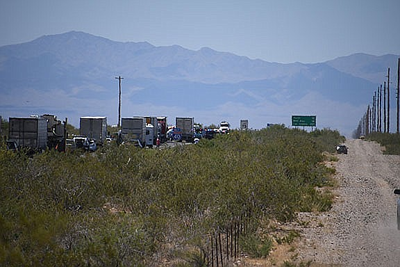 Traffic is stopped on Interstate 40 after a wrong-way crash Friday, May 24, 2019, near Kingman. At least five people were confirmed dead, state troopers said Friday. The accident was just the latest in a string of fatal wrong-way wrecks this year in Arizona, which has a continuing problem with deadly crashes blamed on drivers headed the wrong way. (Vanessa Espinoza/Kingman Daily Miner)