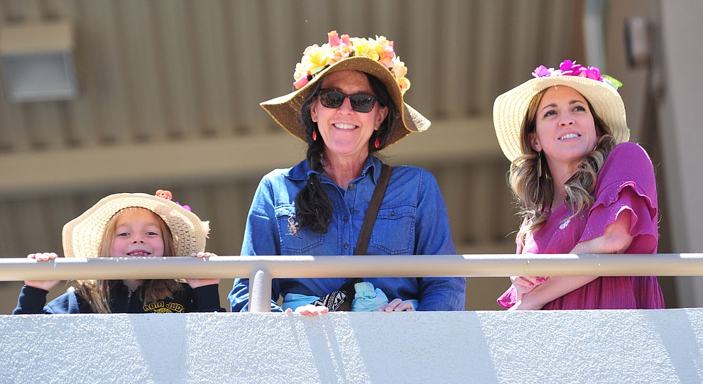 Brynlee Smith, Kathy Vallely and Mattie Smith don their best headwear for opening day of Arizona Downs Friday, May 24 in Prescott Valley. The racetrack reopens under new ownership after being closed for 10 years. (Les Stukenberg/Courier)