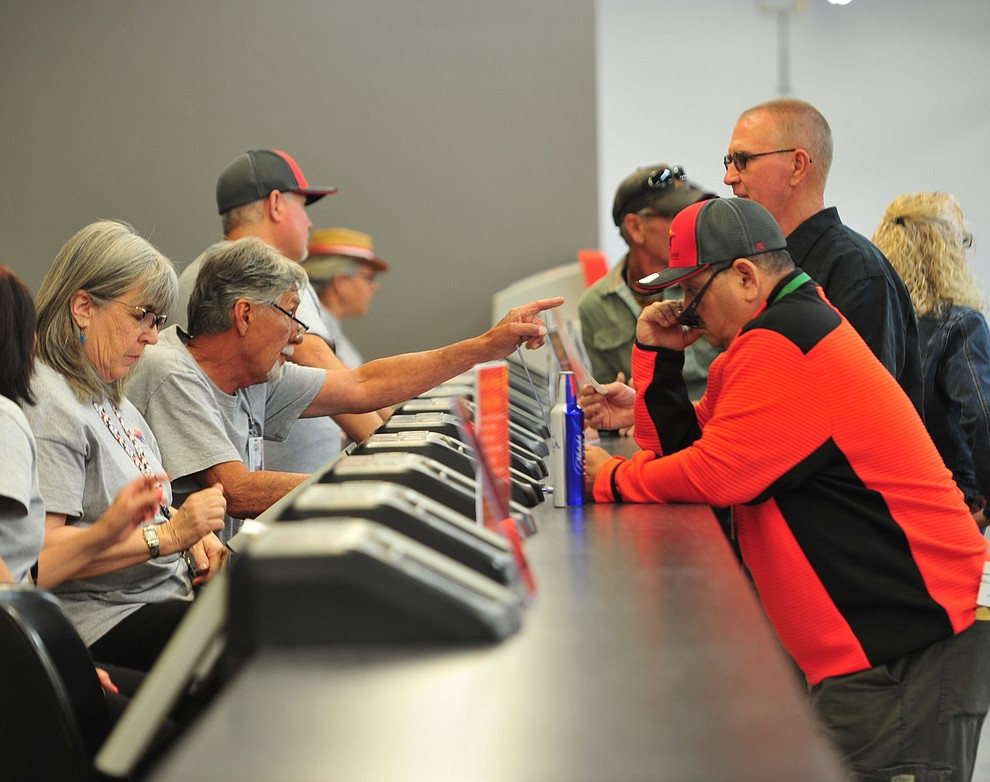 People get their bets in at opening day of Arizona Downs Friday, May 24 in Prescott Valley. The racetrack reopens under new ownership after being closed for 10 years. (Les Stukenberg/Courier)
