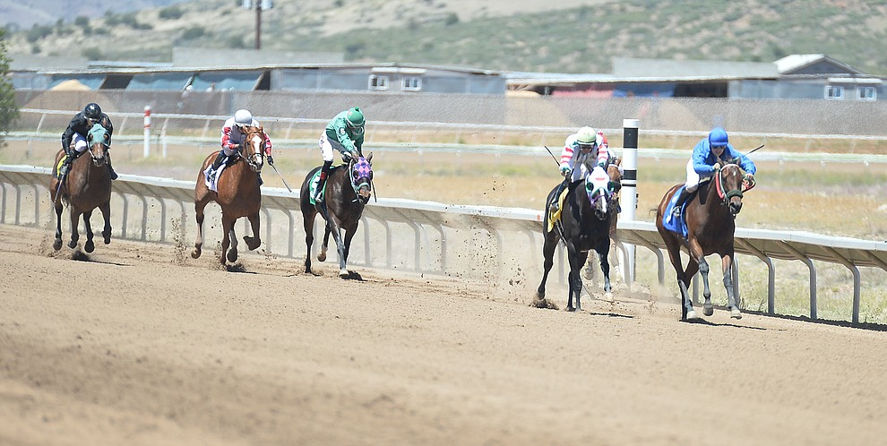 Horses come down the stretch in the second race at opening day of Arizona Downs Friday, May 24 in Prescott Valley. The racetrack reopens under new ownership after being closed for 10 years. (Les Stukenberg/Courier)