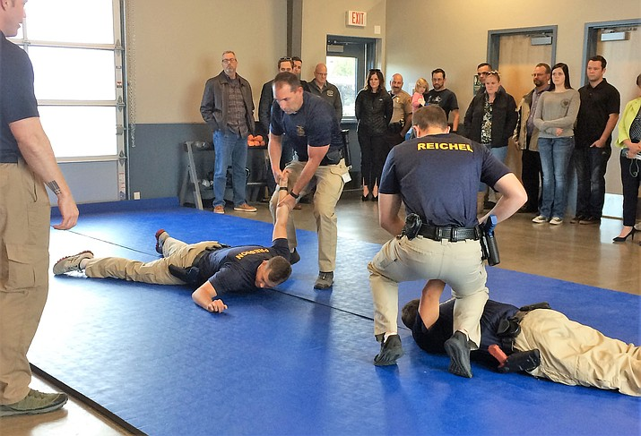 Yavapai County Sheriff's Office Deputy Steve Berry runs pairs of recruits through a demonstration of defensive tactics at the NARTA Open House May 21 as members of the community look on. (Sue Tone/Prescott News Network)
