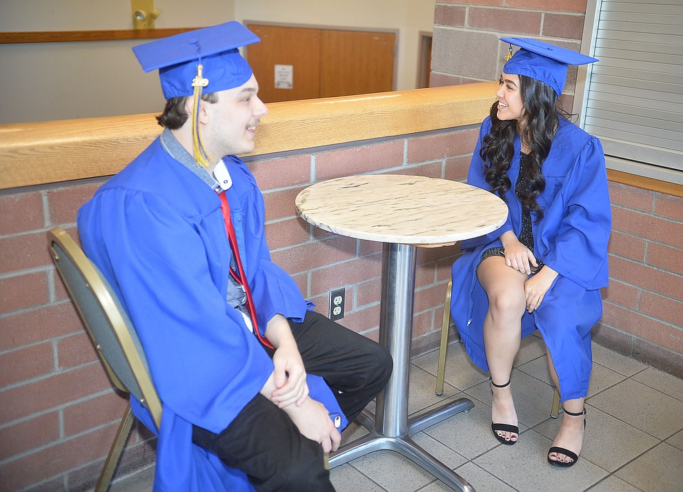 Dillon Music and Arieanna Golden relax before Prescott High School graduated 301 students in a commencement ceremony Friday, May 24 on Bill Shepard Field in Prescott. (Les Stukenberg/Courier)