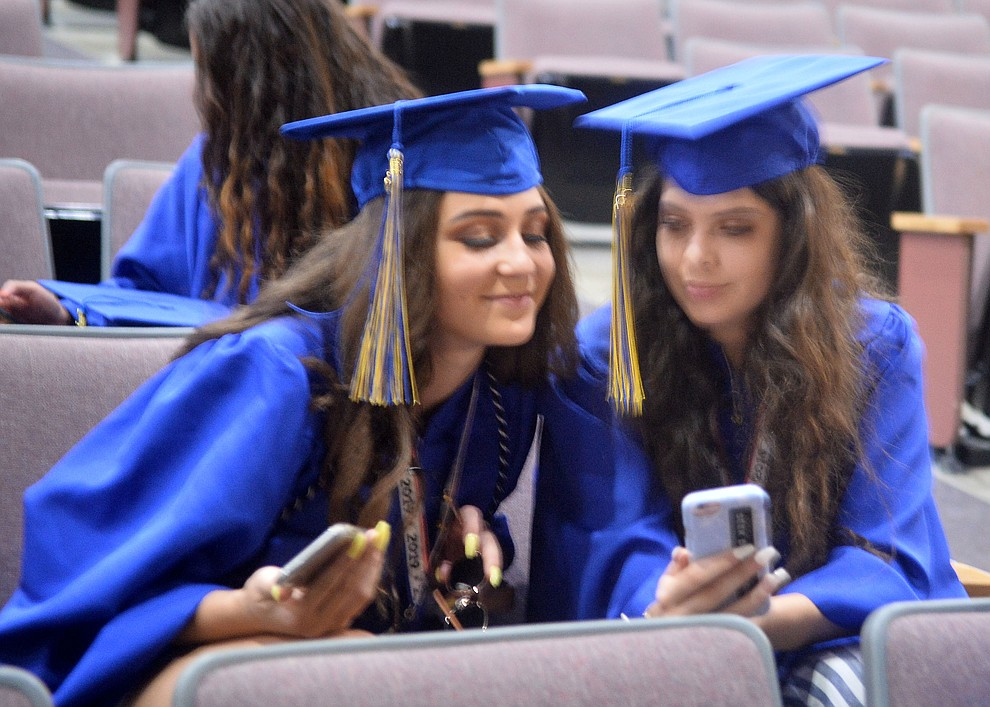 Cienna Madrigal and Tessa Eppele before Prescott High School graduated 301 students in a commencement ceremony Friday, May 24 on Bill Shepard Field in Prescott. (Les Stukenberg/Courier)