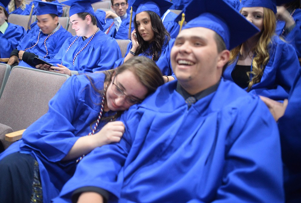 KhiernanDevault-Harrell rests her head on Robert Oldfield's shoulder before Prescott High School graduated 301 students in a commencement ceremony Friday, May 24 on Bill Shepard Field in Prescott. (Les Stukenberg/Courier)