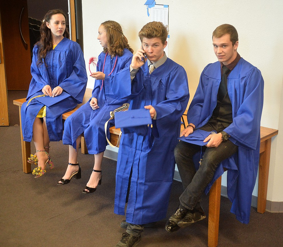 Maggie Rathbun, Kaitlyn Gagnon, Robert Hussen and Drew Crawford in the lobby of the Ruth Street Theatre before Prescott High School graduated 301 students in a commencement ceremony Friday, May 24 on Bill Shepard Field in Prescott. (Les Stukenberg/Courier)