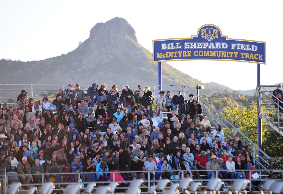 Thumb Butte stands majestic as Prescott High School graduated 301 students in a commencement ceremony Friday, May 24 on Bill Shepard Field in Prescott. (Les Stukenberg/Courier)
