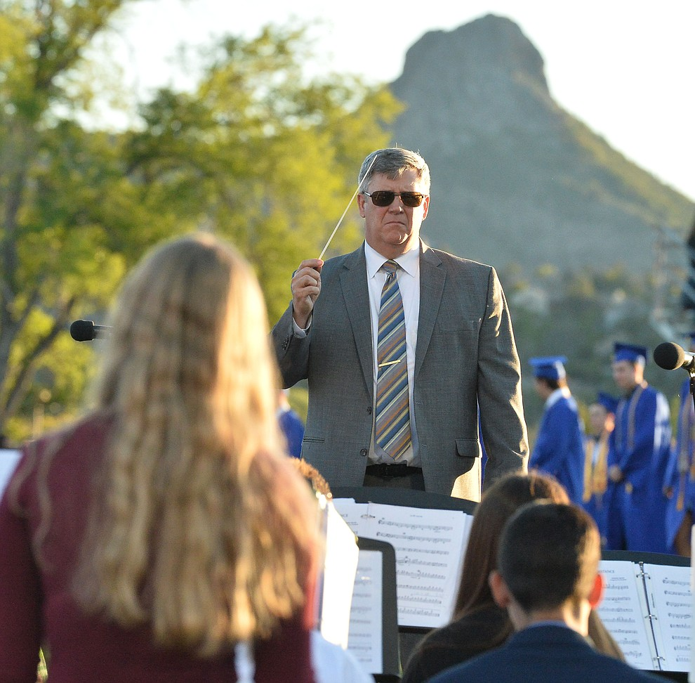 Dan Bradstreet conducts the concert band as Prescott High School graduated 301 students in a commencement ceremony Friday, May 24 on Bill Shepard Field in Prescott. (Les Stukenberg/Courier)