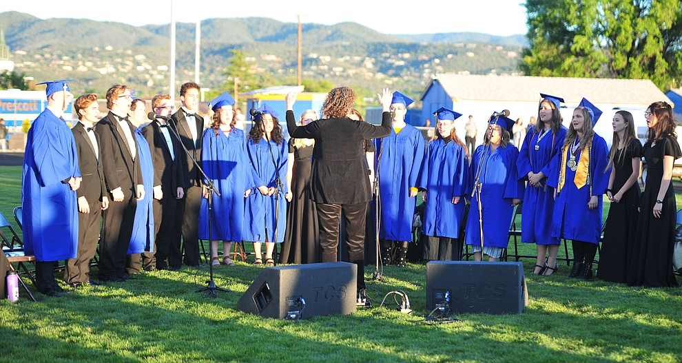 The Prescott High School Chamber Singers sing the National Anthem as Prescott High School graduated 301 students in a commencement ceremony Friday, May 24 on Bill Shepard Field in Prescott. (Les Stukenberg/Courier)