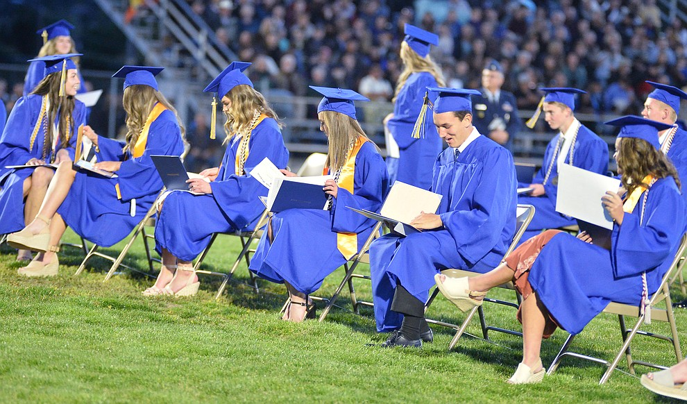 Students get their first glance at their diploma as Prescott High School graduated 301 students in a commencement ceremony Friday, May 24 on Bill Shepard Field in Prescott. (Les Stukenberg/Courier)