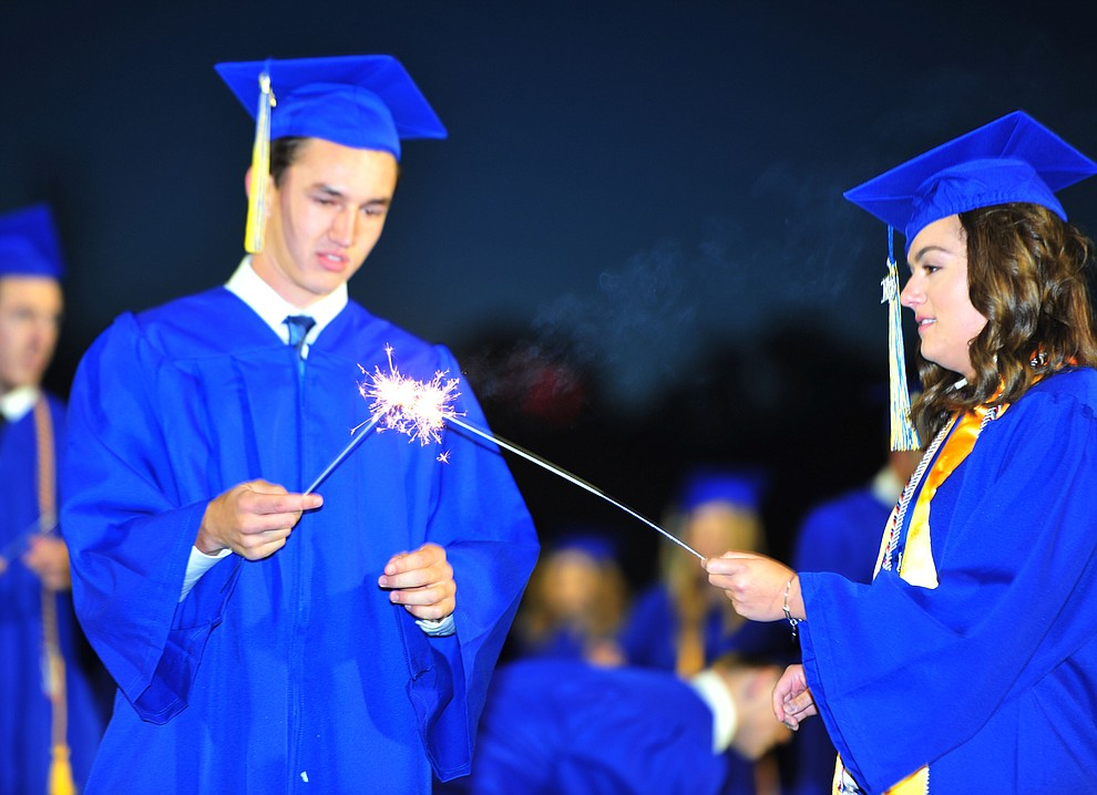 Students light sparklers as Prescott High School graduated 301 students in a commencement ceremony Friday, May 24 on Bill Shepard Field in Prescott. (Les Stukenberg/Courier)