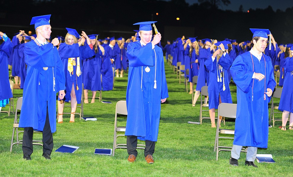Students turn their tassles as Prescott High School graduated 301 students in a commencement ceremony Friday, May 24 on Bill Shepard Field in Prescott. (Les Stukenberg/Courier)