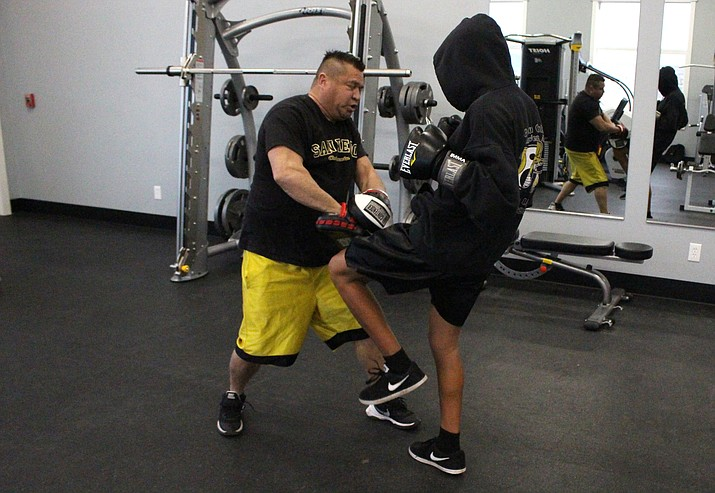 Richard Williams trains Adam Hines last year. Williams, also a promoter, is putting together an IKF event called the Golden Rumble at Reese's Tire Pros in Cottonwood on June 22. VVN/James Kelley