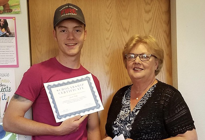 Jacob Shelly is the recipient of Bookmarks - Friends of the Cottonwood Library $1000. scholarship. Jacob is a senior at Mingus Union High School with dual enrollment in the Fire Science program at Yavapai College. He will attend Northern Arizona University with a major in forestry. Jacob is pictured with Patricia Nomm, chair of the scholarship committee.