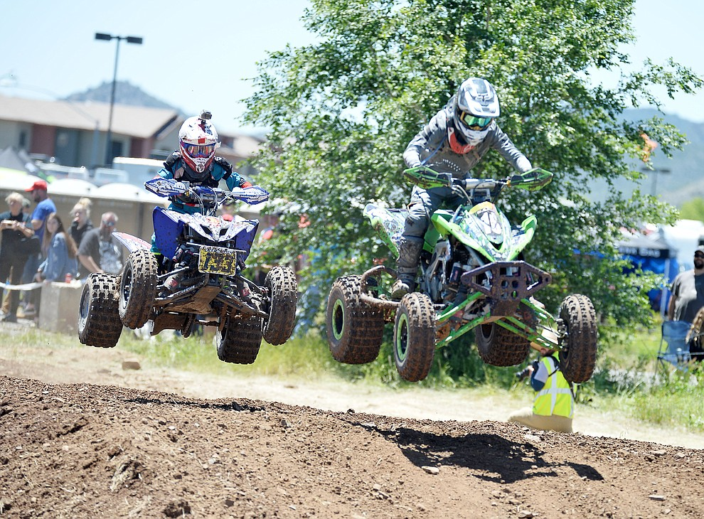 Quads fly through the air at the noon time hour during Arizona Off Road Promotion's Prescott Valley Grand Prix near the Findlay Toyota Center Saturday, May 25. in Prescott Valley. (Les Stukenberg/Courier)