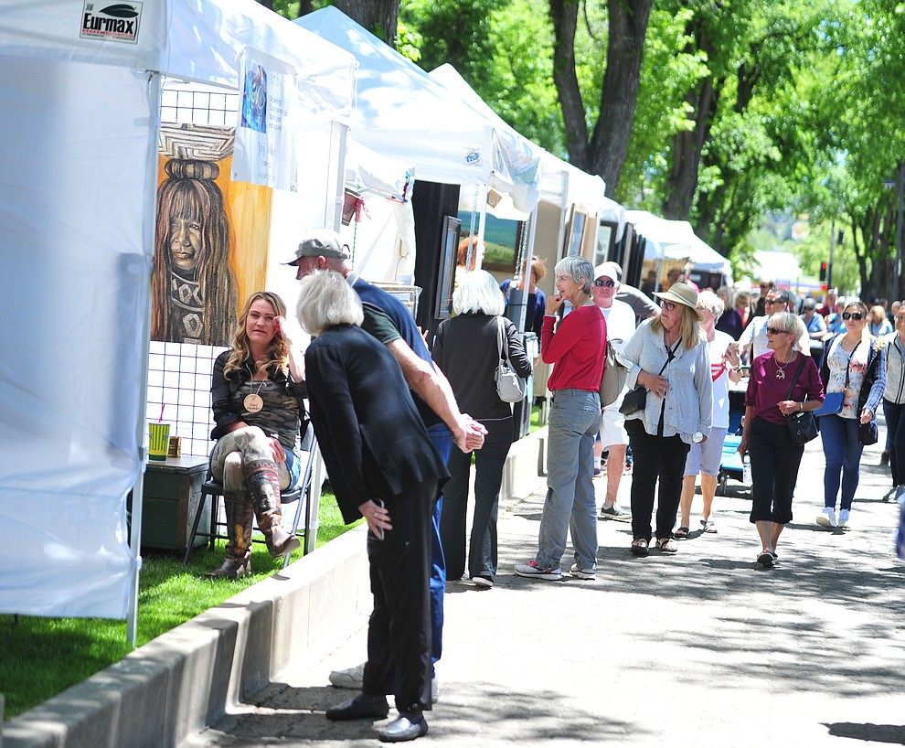 Crowds browse the booths at the Phippen Western Art Show & Sale Saturday, May 25. in on the Courthouse Plaza in Prescott. (Les Stukenberg/Courier)