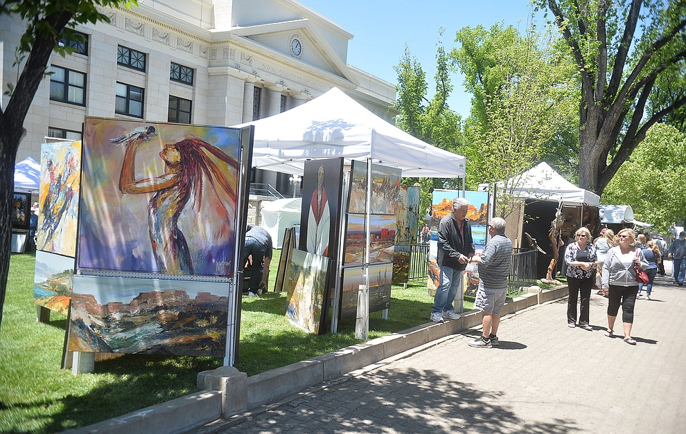 Michael Nisperos has his artwork on display at the Phippen Western Art Show & Sale Saturday, May 25. in on the Courthouse Plaza in Prescott. (Les Stukenberg/Courier)