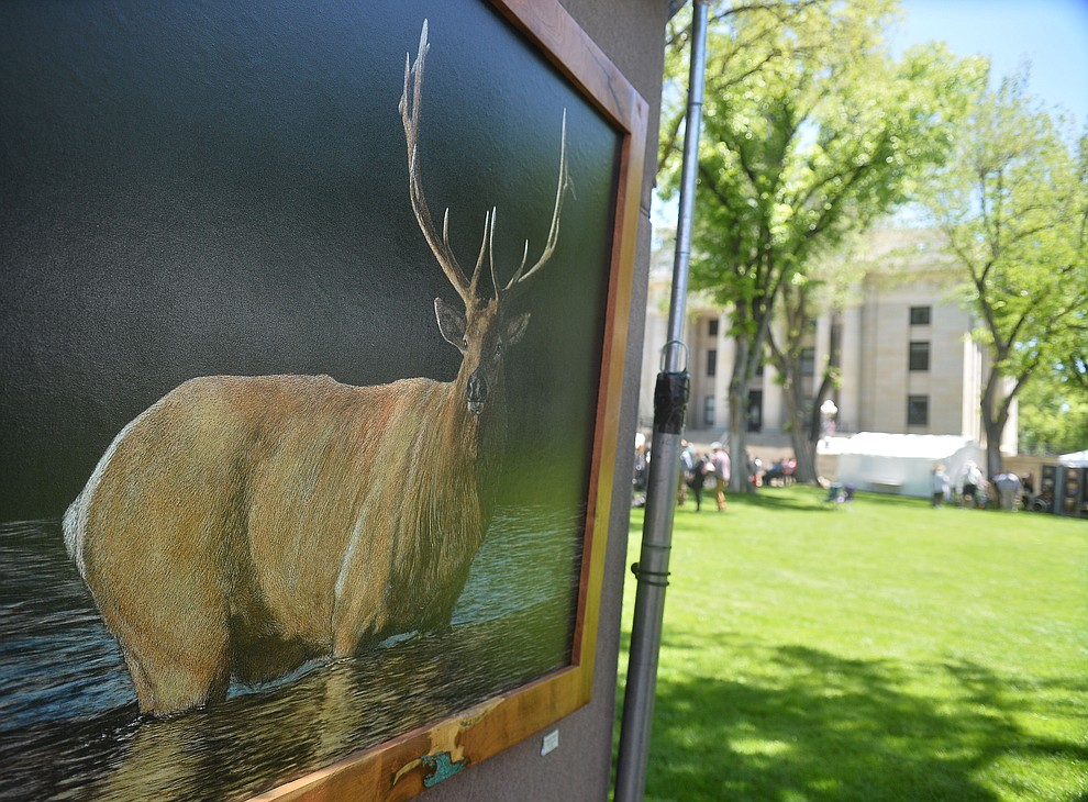 Paul Hopman's Along the Madison overlooks the grass at the Phippen Western Art Show & Sale Saturday, May 25. in on the Courthouse Plaza in Prescott. (Les Stukenberg/Courier)