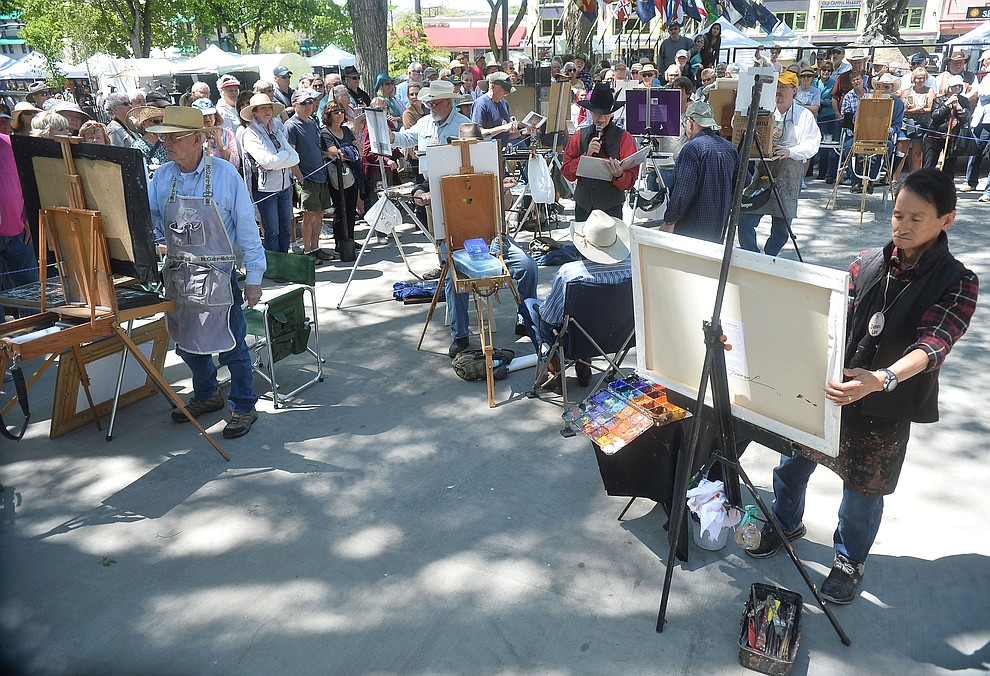 Artists paint in the quick draw contest at the Phippen Western Art Show & Sale Saturday, May 25. in on the Courthouse Plaza in Prescott. (Les Stukenberg/Courier)