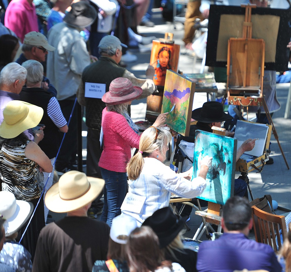 Crowds watch the painters in the quick draw contest at the Phippen Western Art Show & Sale Saturday, May 25. in on the Courthouse Plaza in Prescott. (Les Stukenberg/Courier)