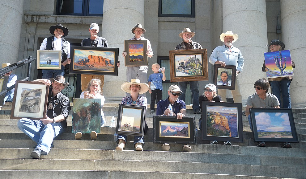 Artists pose with their work following the quick draw contest at the Phippen Western Art Show & Sale Saturday, May 25. in on the Courthouse Plaza in Prescott. (Les Stukenberg/Courier)