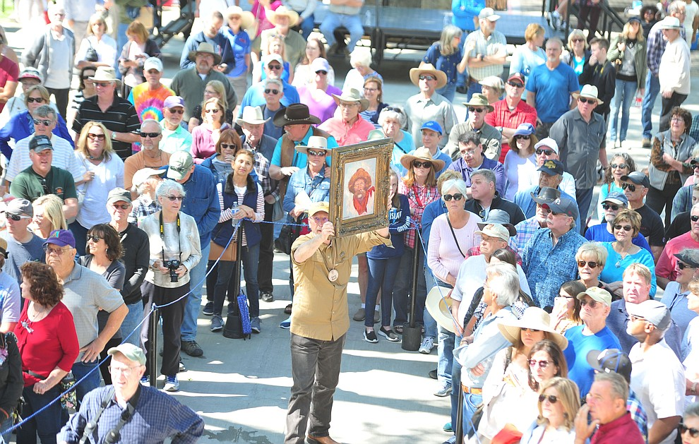 Crowds gather for the auction of the quick draw paintings at the Phippen Western Art Show & Sale Saturday, May 25. in on the Courthouse Plaza in Prescott. (Les Stukenberg/Courier)