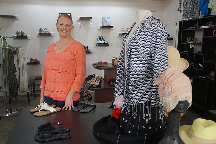 Terri Harrington, new owner of the SMARTgirls Resale Fashion shop in Prescott Valley, said there have been few changes at the store since she took on ownership in February. Harrington conducted a grand opening for the store this past week. (Cindy Barks/Courier)