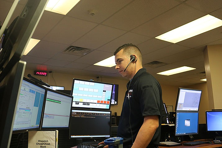 Dispatcher TJ Pena advises that those calling 911 lead with the most severe, chief issue they're facing. (Photo by Travis Rains/Daily Miner)