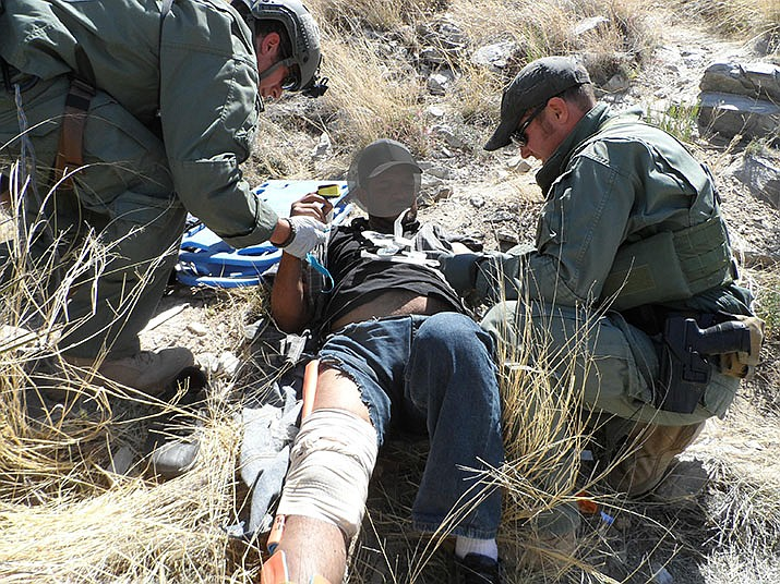 Border Patrol Search Trauma and Rescue render first aid to an injured migrant in this Sept. 13, 2016 photo. (U.S. Border Patrol photo)