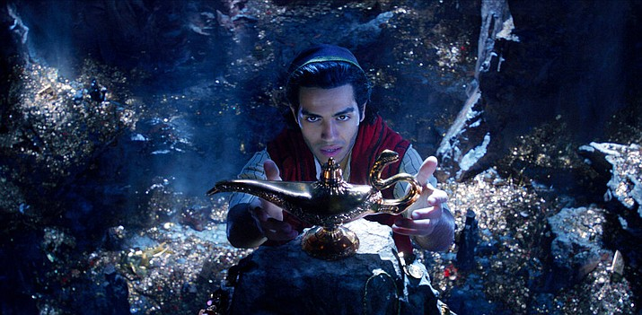 "This image released by Disney shows Mena Massoud as Aladdin in Disney's live-action adaptation of the 1992 animated classic ""Aladdin."" (Disney via AP)"
