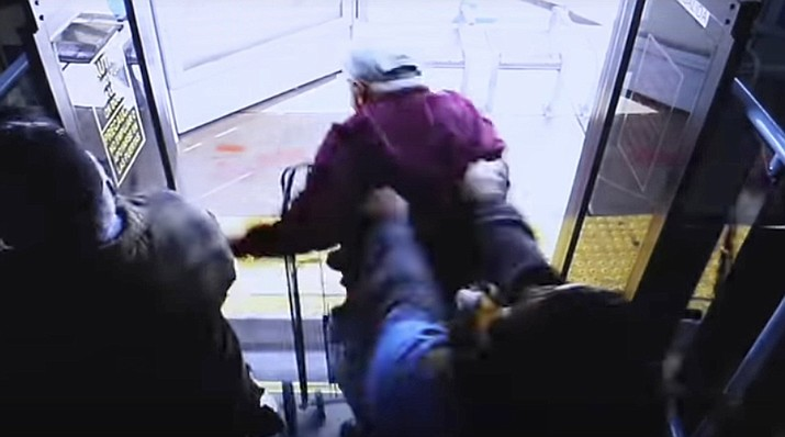 In this still image taken from security video and provided by the Las Vegas Metropolitan Police Department, a woman shoves a 74-year-old man off a public transit bus on March 21, 2019. The man, Serge Fournier, hit his head on the sidewalk and died a month later. The Clark County coroner ruled his death a homicide resulting from his injuries. Cadesha Michelle Bishop was arrested Monday, May 13, 2019, and is scheduled to appear in court on May 21. (Las Vegas Metropolitan Police Department)