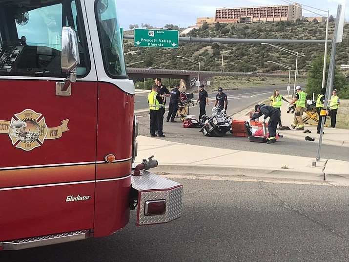 Members of the Prescott Fire Department help two people involved in a motorcycle accident near Overland Road and the Highway 89 and 69 interchange Sunday, May 26, 2019. (Prescott Fire/Courtesy)