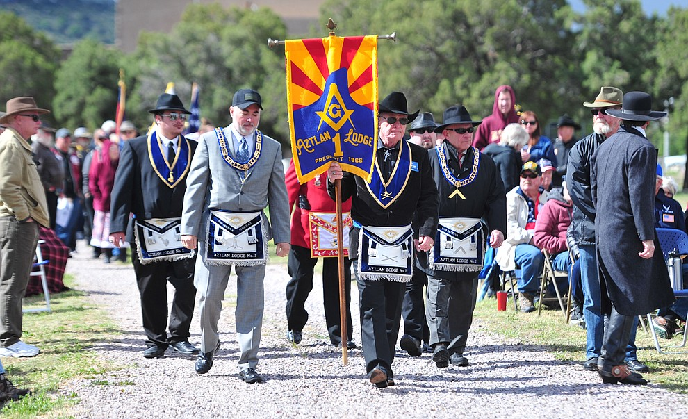 Community organizations march in the processional during the Memorial Day Ceremony at the Citizens Cemetery Monday, May 27 in Prescott. (Les Stukenberg/Courier)