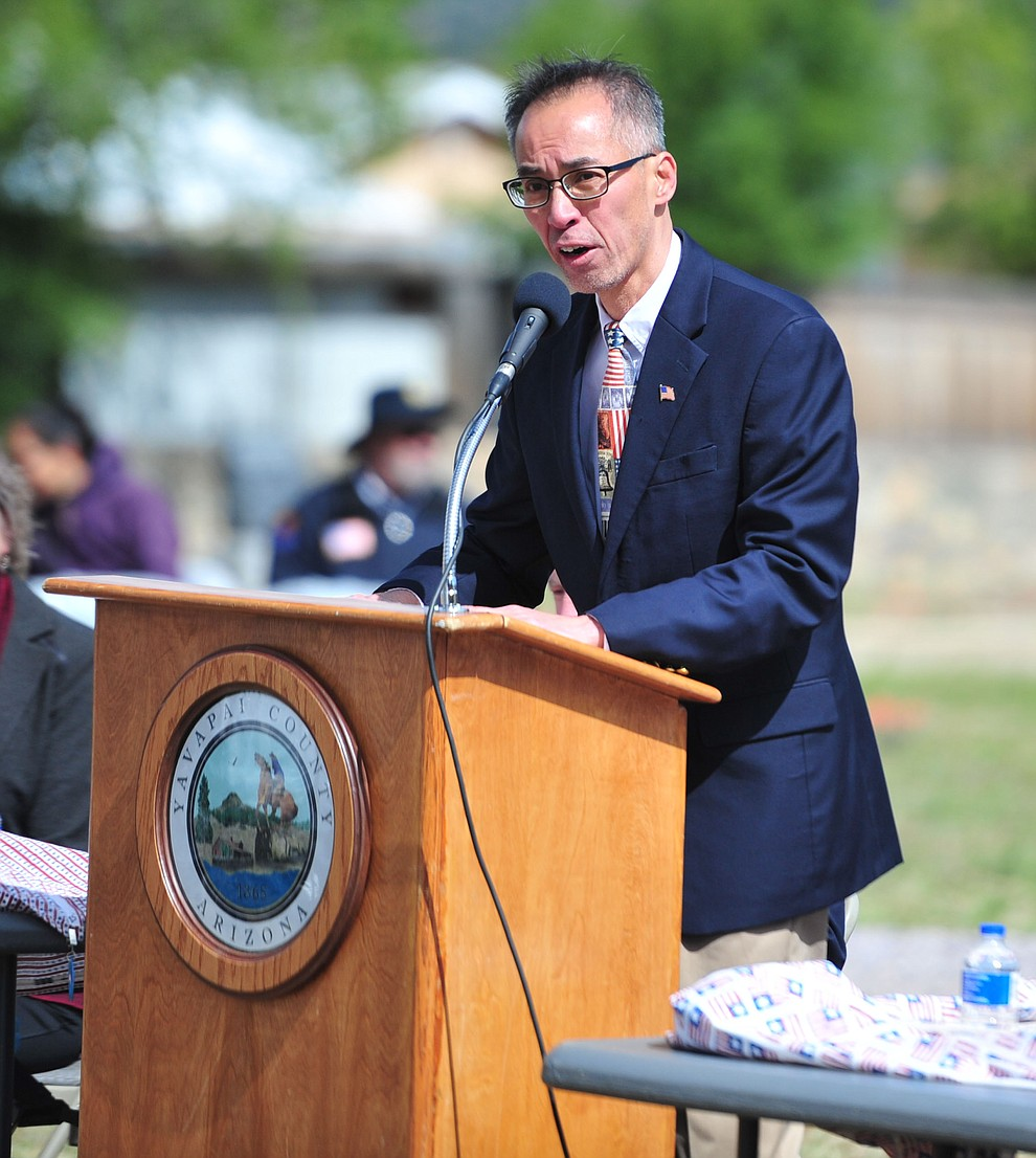 Quang Nguyen speaks during the Memorial Day Ceremony at the Citizens Cemetery Monday, May 27 in Prescott. (Les Stukenberg/Courier)
