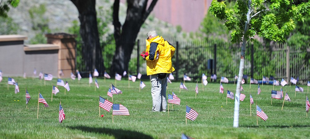 John Bostwick looks at the grave of a British soldier before the Memorial Day Ceremony at the National Cemetery Monday, May 27 in Prescott. (Les Stukenberg/Courier)
