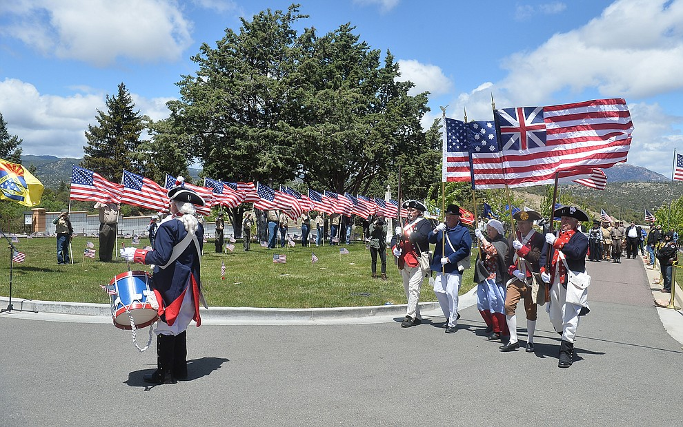 Members of the Sons of the American Revolution march in the processional during the Memorial Day Ceremony at the National Cemetery Monday, May 27 in Prescott. (Les Stukenberg/Courier)