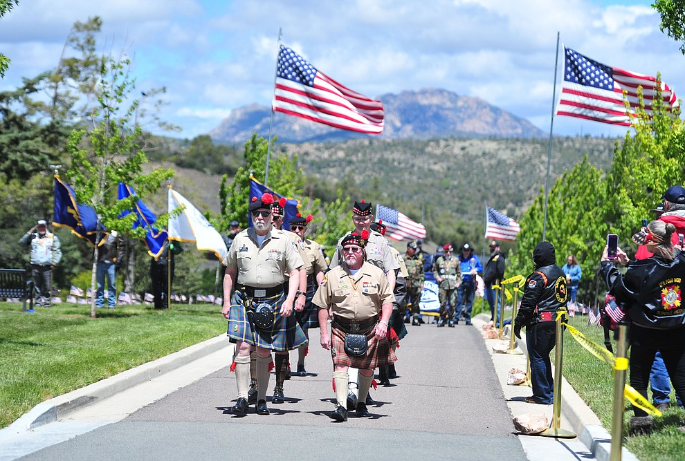 Members of the Scottish American Military Society march in the processional during the Memorial Day Ceremony at the National Cemetery Monday, May 27 in Prescott. (Les Stukenberg/Courier)