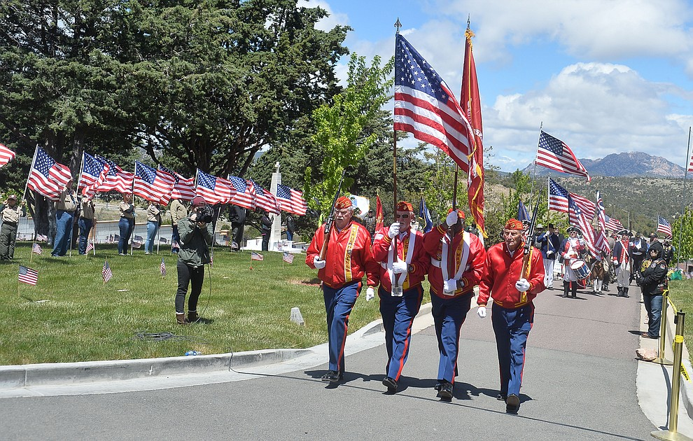 The Marine Corps League Color Guard marches in the processional during the Memorial Day Ceremony at the National Cemetery Monday, May 27 in Prescott. (Les Stukenberg/Courier)