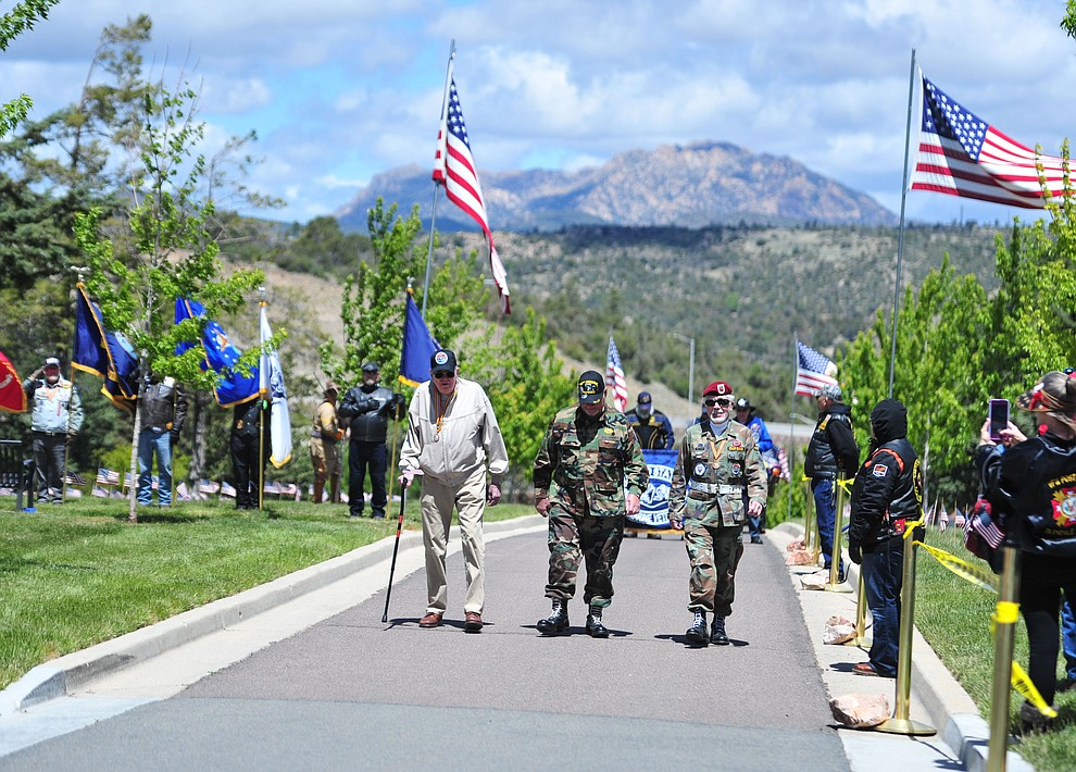 Members of the Northern Arizona All Airborne march in the processional during the Memorial Day Ceremony at the National Cemetery Monday, May 27 in Prescott. (Les Stukenberg/Courier)