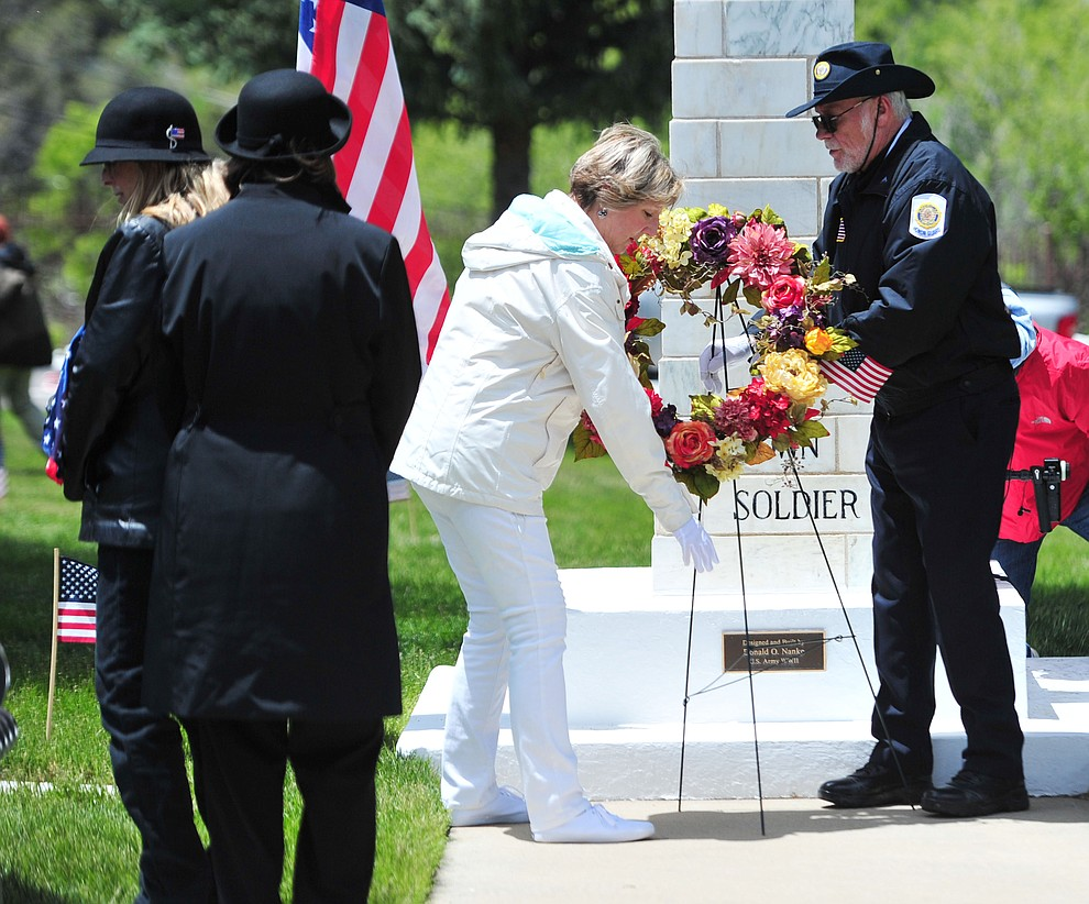 American Gold Star Mothers present a wreath at the Unknown Soldier monument during the Memorial Day Ceremony at the National Cemetery Monday, May 27 in Prescott. (Les Stukenberg/Courier)