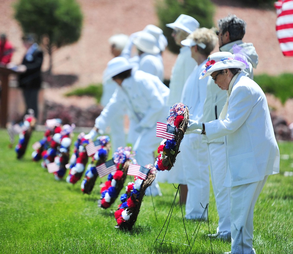 Members of various military fraternal organizations present wreaths in an Aisle of Honor during the Memorial Day Ceremony at the National Cemetery Monday, May 27 in Prescott. (Les Stukenberg/Courier)