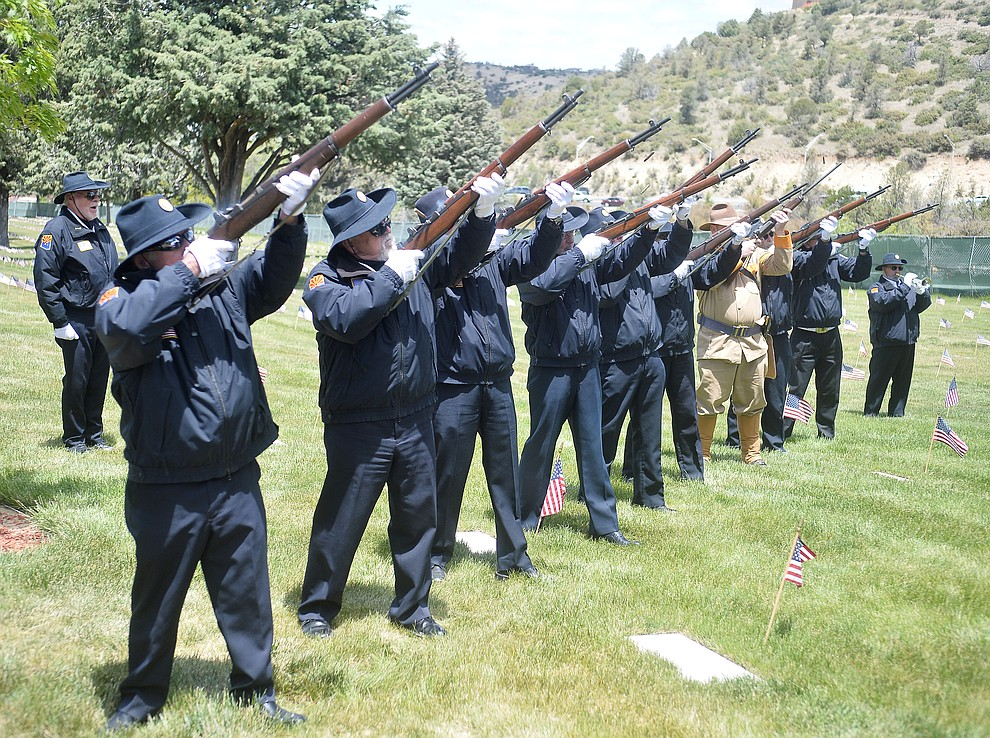 Members of the American Legion Post 6 Honor Guard and Arizona Roughriders fire a volley during the Memorial Day Ceremony at the National Cemetery Monday, May 27 in Prescott. (Les Stukenberg/Courier)