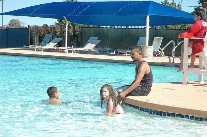 John Rodriguez with his kids, Mia and Trae Rodriguez swimming at Mountain Valley Splash on opening day Saturday, May 25. Open swim at Mountain Valley Splash is from 1 to 4:30 p.m. daily through Sunday, Aug. 3. Entry fees are $3.50 for 17 and younger and seniors and $4.50 for adults. (Jason Wheeler/Courier)