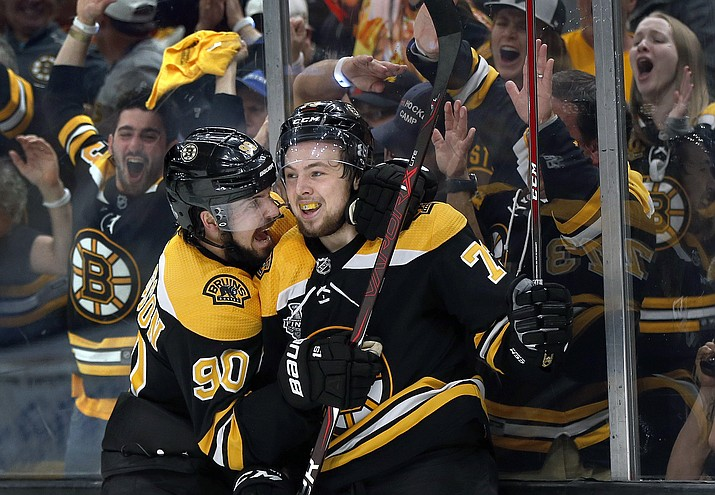Boston Bruins' Charlie McAvoy, right, celebrates his goal against the St. Louis Blues with Marcus Johansson, left, during the second period in Game 1 of the NHL hockey Stanley Cup Final, Monday, May 27, 2019, in Boston. (Michael Dwyer/AP)